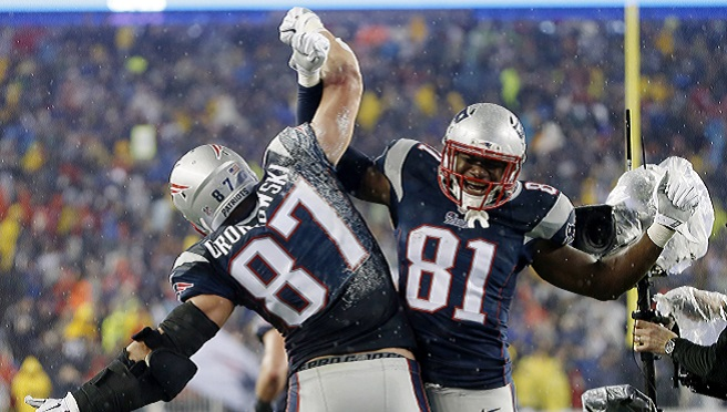 New England Patriots tight end Rob Gronkowski (87) celebrates with teammate Timothy Wright after his five-yard touchdown pass during the second half of the NFL football AFC Championship game against the Indianapolis Colts Sunday, Jan. 18, 2015, in...