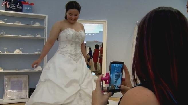Bride trying on wedding dresses_272271