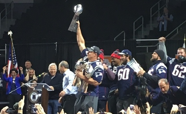 Gronk holds up Vince Lombardi trophies at Providence rally_420582