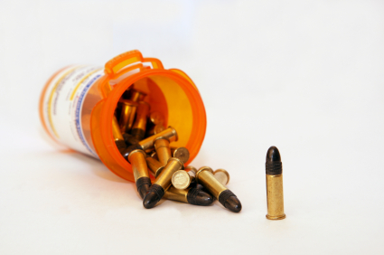 Image shows pill bottle with bullets spilling out of it instead of pills on white background
