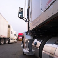 Movement and parking of semi trucks at truck stop_224354