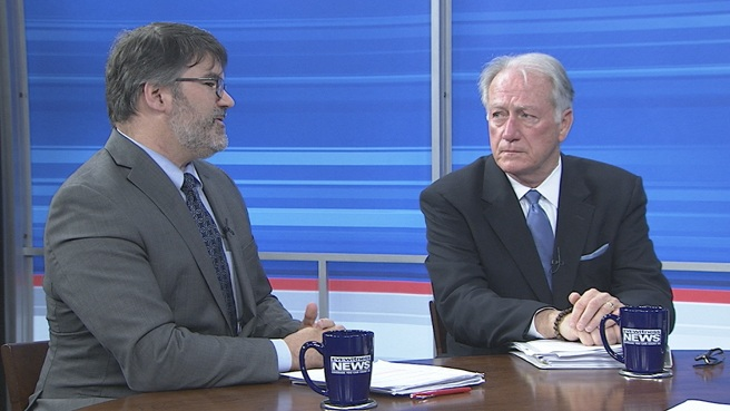 John Simmons (right), president and CEO of the Rhode Island Public Expenditure Council, talks with Douglas Hall during a taping of WPRI's Newsmakers.