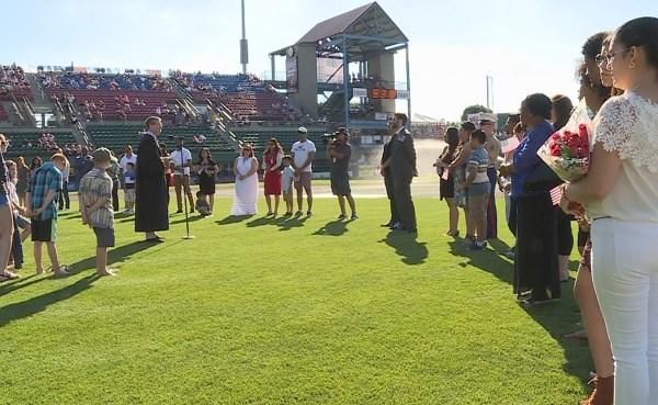 Naturalization ceremony at McCoy Stadium_508330