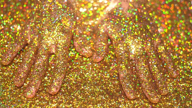 Woman's hand in golden glitter_599602
