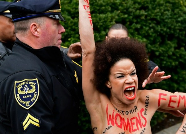 bill cosby trial topless protester