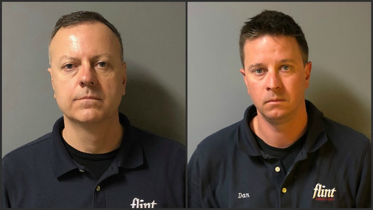 Flint Audio Video owners arrested