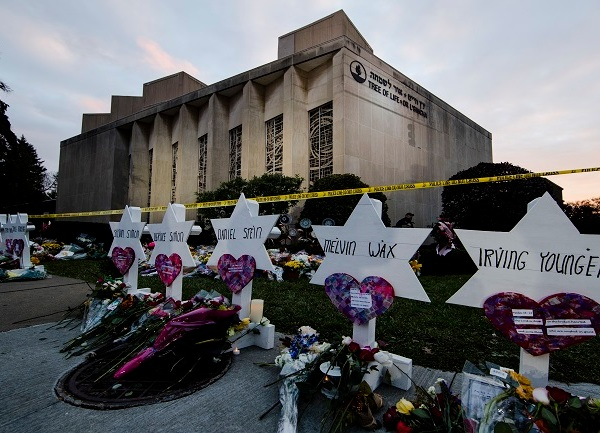 Rampage victims' funerals begin as Trump heads to Pittsburgh