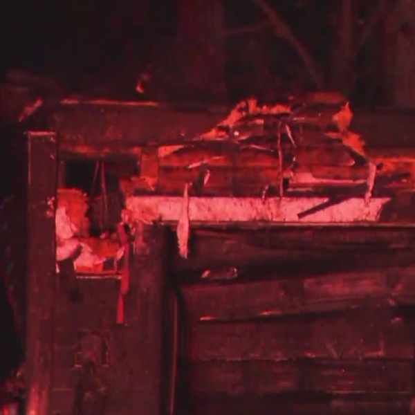 Firefighters stop garage fire from spreading to home