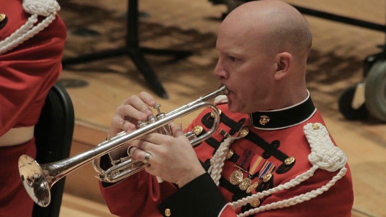 Local member of marine band plays at funeral of President George HW Bush