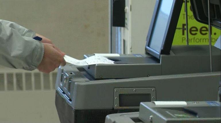 providence-feeding-ballot-into-voting-machine_1541529080093.JPG