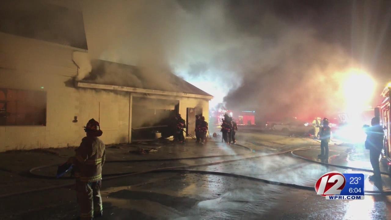 Flames break out at Connecticut auto body shop