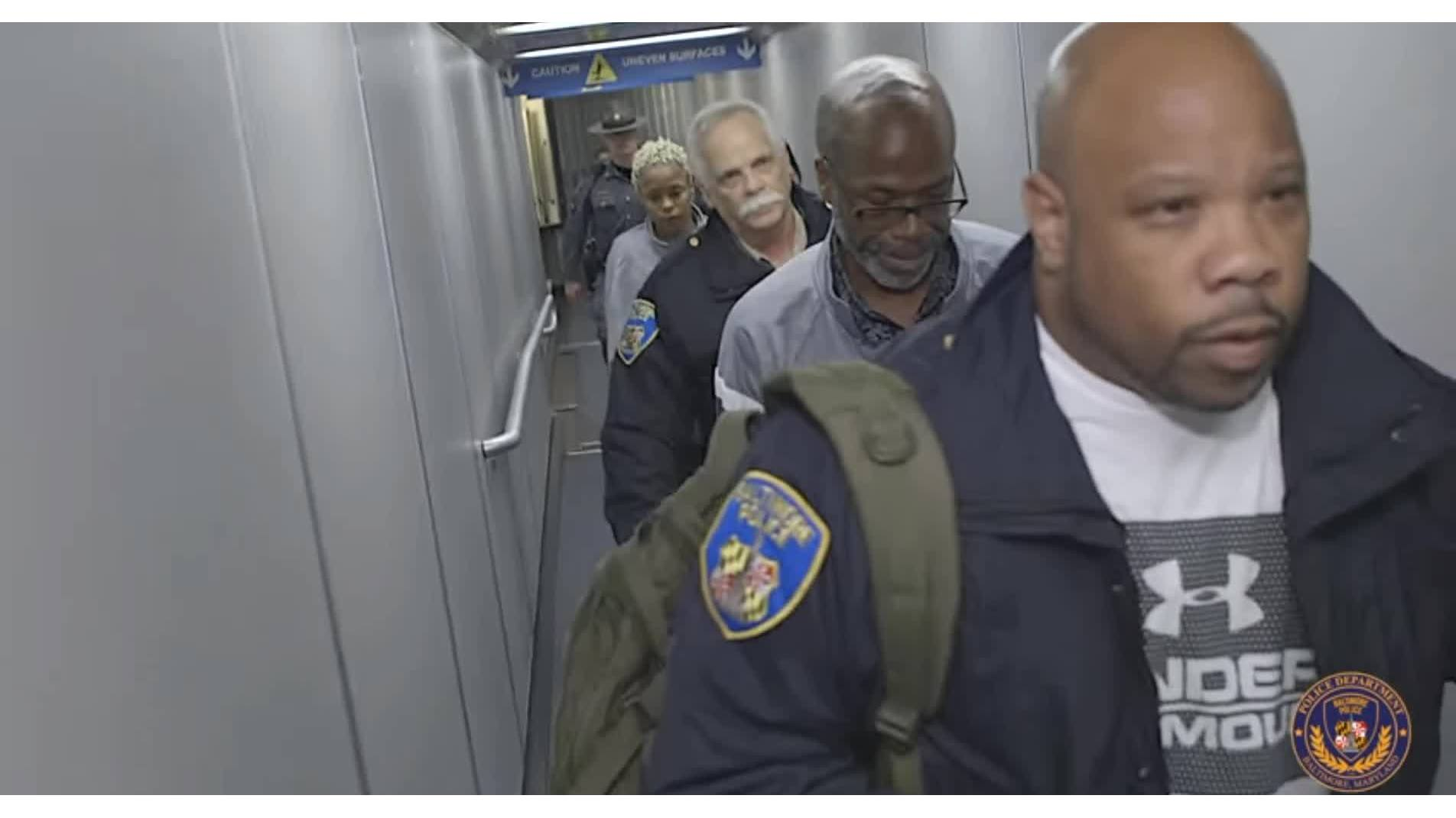 Murder Victim's Husband, Daughter Arrive in Baltimore to Face Charges