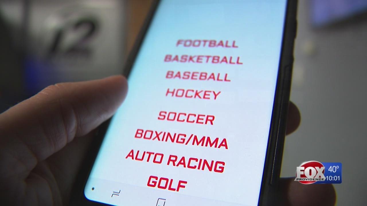 Raimondo signs bill for mobile sports betting