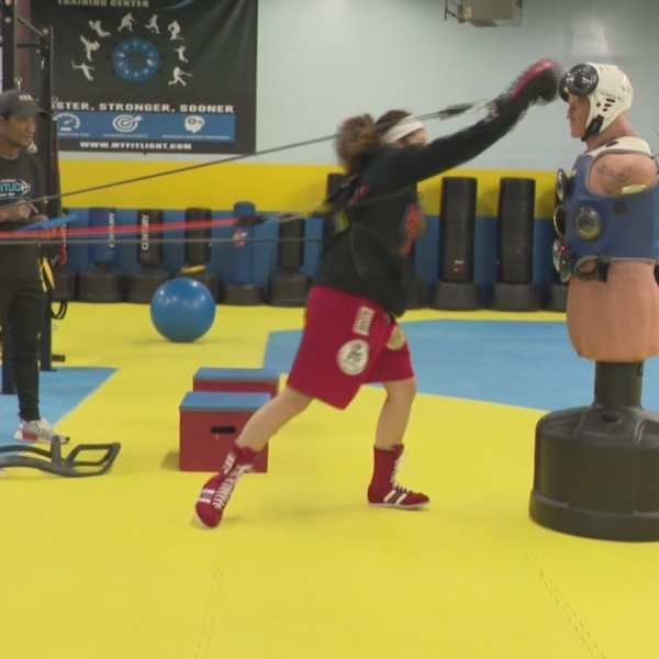 Young, female boxer empowered both inside and outside the ring
