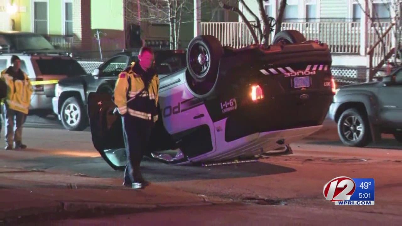 Crash leaves Woonsocket police cruiser on its roof