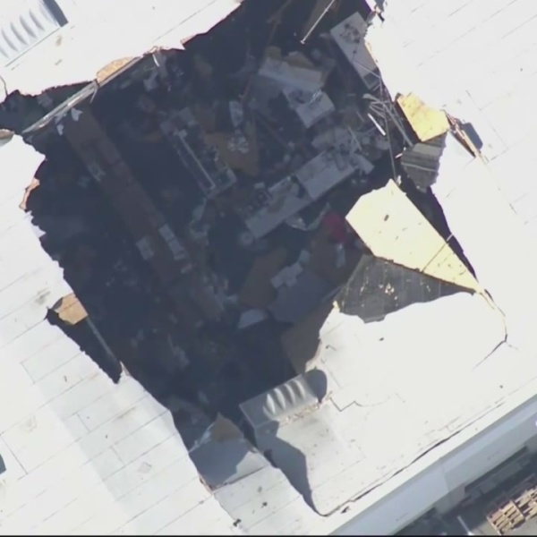 12 exposed to debris, pilot safe after F-16 hits warehouse