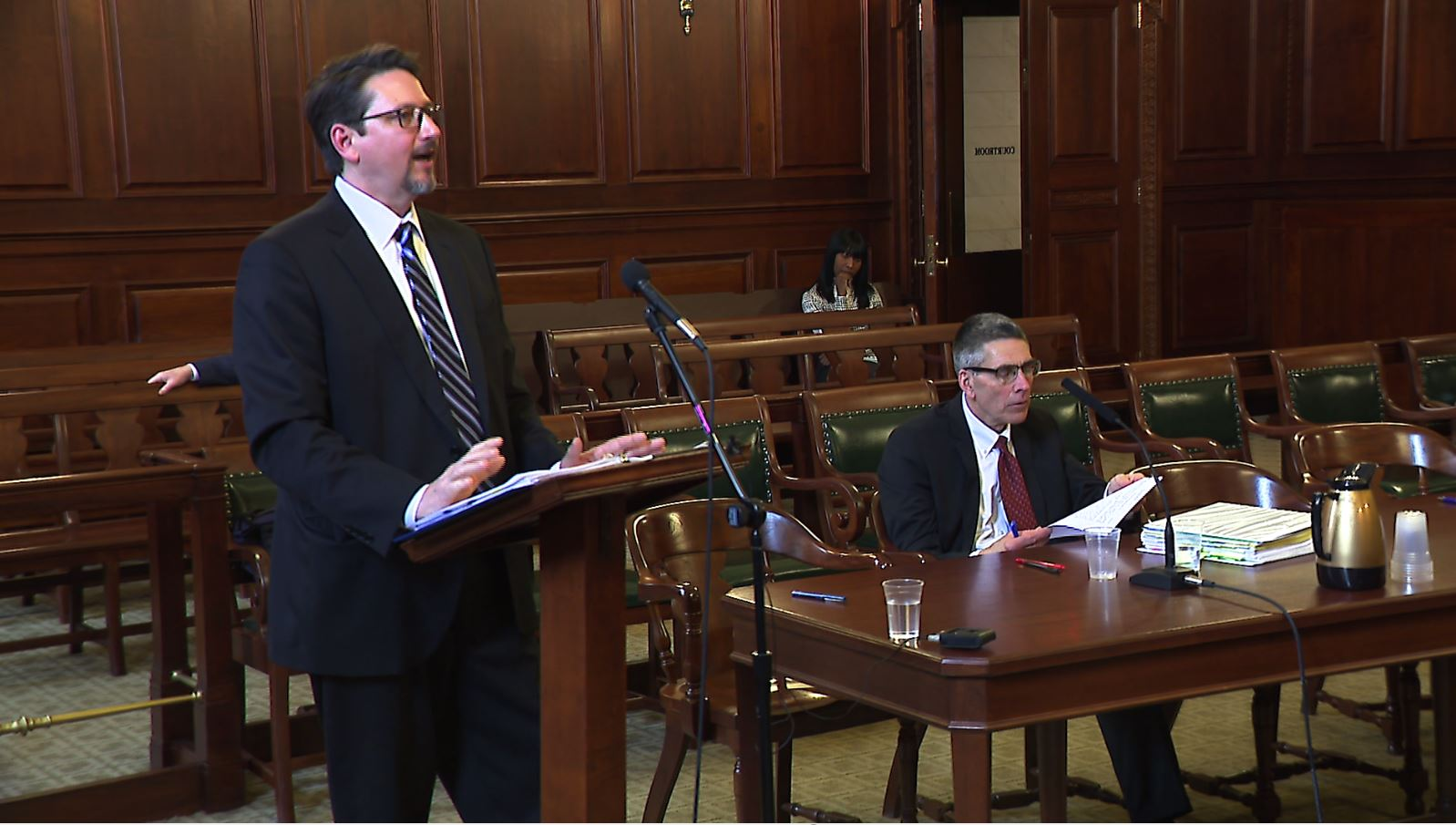 Jason Gramitt (left) of the R.I. Ethics Commission and Marc DeSisto, representing Supreme Court Justice Francis Flaherty, make arguments in an administrative appeal case in Superior Court.